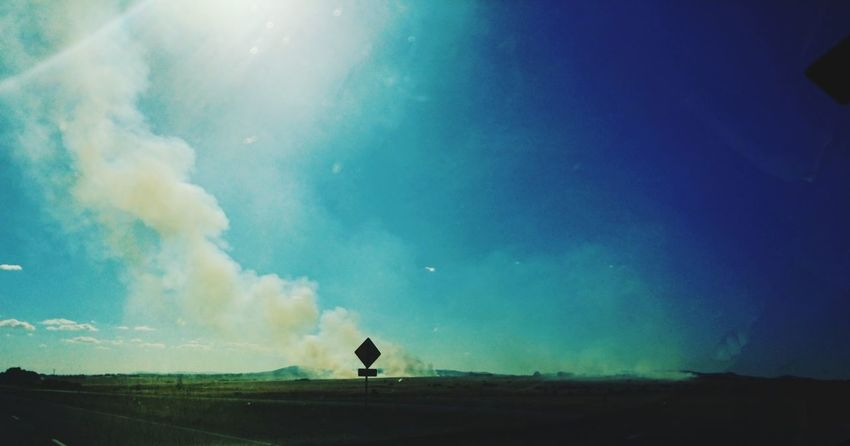 Outdoors Country Country Road Highway Sign Landscape Sky Smoke Fire Lost In The Landscape
