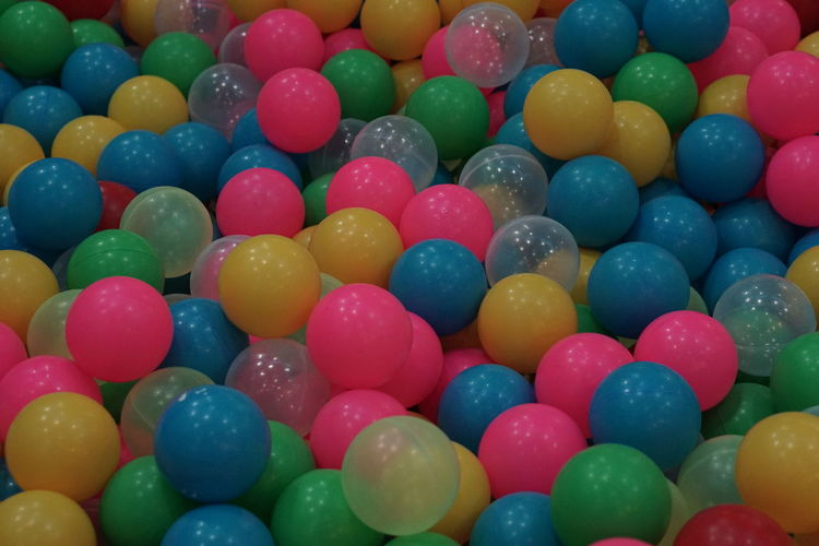 Colored balls in the ball pit Backgrounds Ball Ball Pit Ball Pool Ballpit Blue Close-up Colored Balls Colorful Geometric Shape Green Indoors  Multi Colored No People Pink Round Balls Still Life Transparent Variation Vibrant Color Yellow