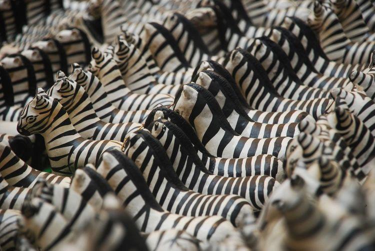 Full frame shot of zebra figurines