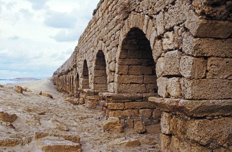 Roman aqueduct on the beach at Caesarea, near Telaviv, Israel Architecture Nature Sky Day History Outdoors Ancient Drinking Water Archaeology Caesarea No People Roman Architecture Aqueduct Travel Destinations Low Angle View Ancient Civilization Cloud - Sky Built Structure Old Ruin Roman Remains Roman City Ancient Walls Beach In Israel Fresh And Salt Water The Traveler - 2018 EyeEm Awards My Best Travel Photo This Is Strength