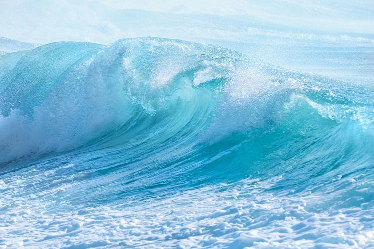 Aerial view of sea waves splashing