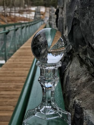 Lens Ball on the Swing Bridge Crystal Ball Photography Lens Ball Bridge Jay Cooke State Park Swing Bridge No People Close-up Day Focus On Foreground Metal Nature Architecture Creativity Reflection Railing