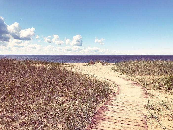 Sky Water Sea Beach Land Horizon Over Water Beauty In Nature Horizon Nature Sunlight Idyllic No People Sand