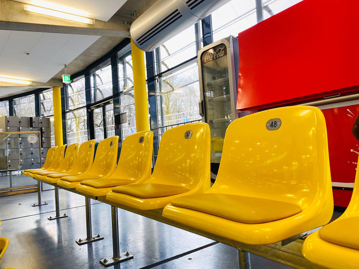 Close-up of yellow chairs in row
