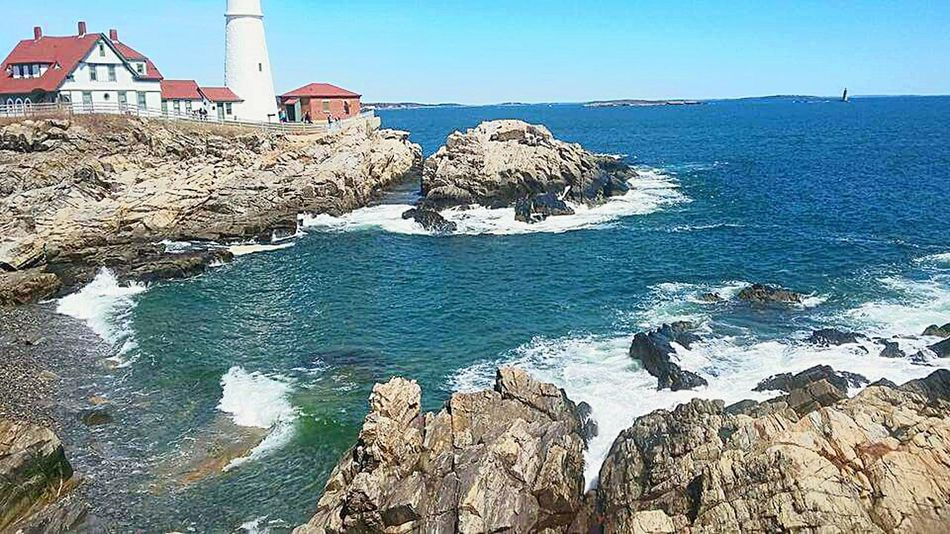Portland Head-Light, Portland, Maine No People Tranquility Beauty In Nature Horizon Over Water Waves Washing Over Rocks Boat Wreck Encased In Rocks Annie Mcguire Beautiful Blue Waters Beautiful Blue Sky☁ My Favorite Place One Earth Day Puffy White Clouds Lighthouse Photography
