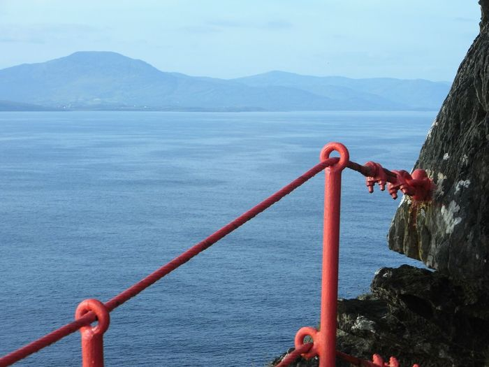 Into the blue Clifftop Handrail  Red Paint Blue Sea Blue Sky Distant Mountains Ocean View Blue Wave Bantry Bay Atlantic Ocean Sheep's Head Way Wildatlanticway Ireland This Is Strength