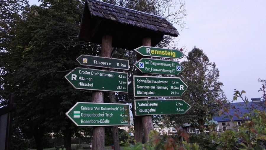 Information sign against trees