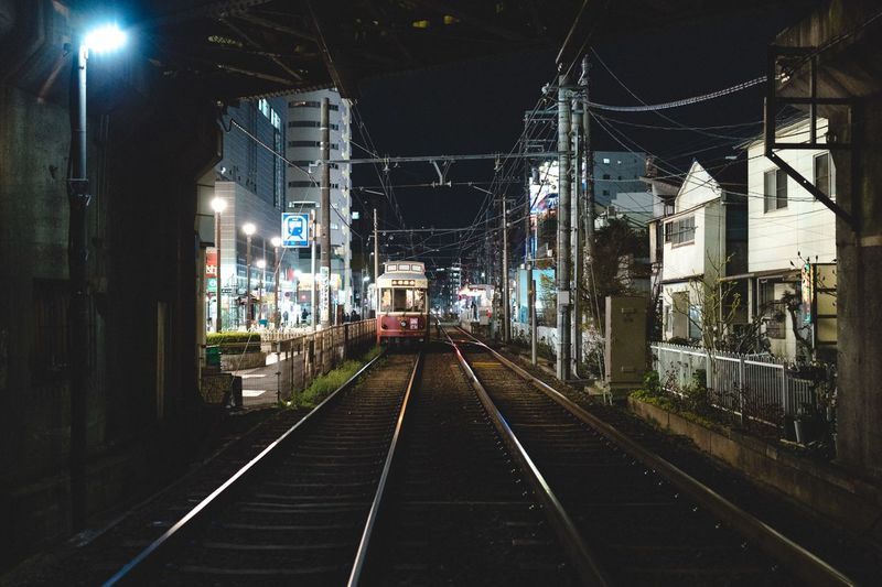 The Way Forward Transportation Illuminated Direction Night Architecture Built Structure Rail Transportation Railroad Track Track Building Exterior No People Lighting Equipment City Road Street Mode Of Transportation Empty Diminishing Perspective Sign