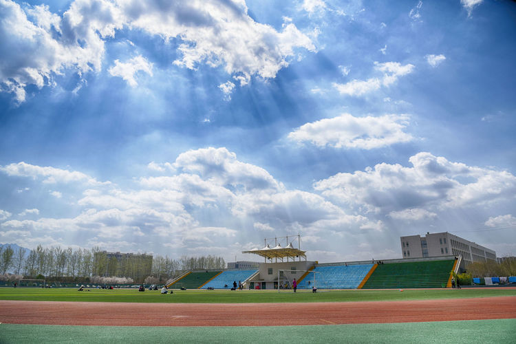 Playground Fun With The Kids University Campus Xian Architecture Building Exterior Built Structure City Cloud - Sky College Day Field Goal Post Grass Nature Outdoors Playground Playing Field Real People School Sky Soccer Soccer Field Sport Tree University