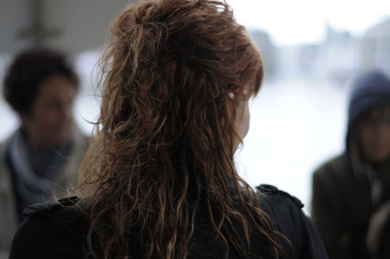 Rear view of woman with wavy hair