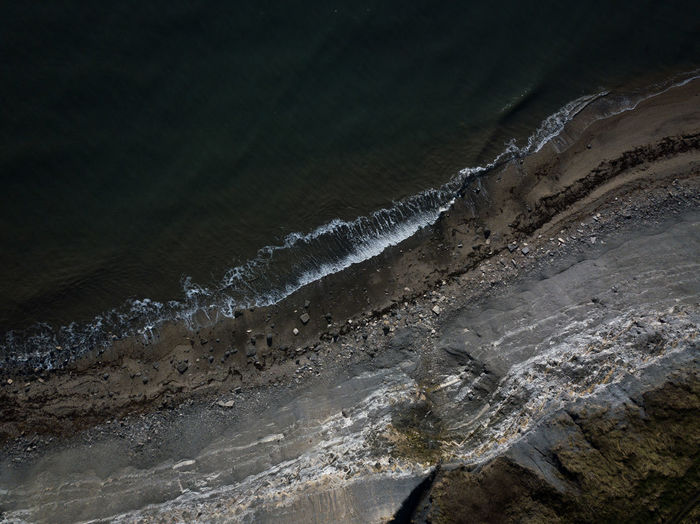 An aerial view of a shoreline in Dorset, UK, January 2019. Water No People Beauty In Nature Nature Environment Scenics - Nature Motion Sea High Angle View Day Geology Outdoors Tranquility Beach Rock Coast Coastline Dorset Jurassic Coast England