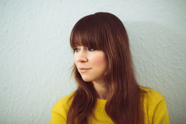 Bangs Beautiful Woman Brown Hair Casual Clothing Close-up Day Headshot Indoors  Long Hair Looking Sideways One Person People Portrait Real People Redhead Yellow Young Adult Young Women