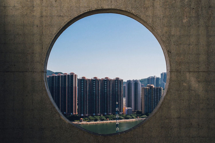 Modern Buildings In City Seen Through Circular Window