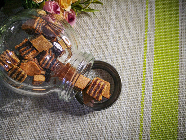 Closeup and selective focus a Sarawak Layer Cake or local called Kek Lapis with minimal lighting and flare serve on the top of table. Sarawakmalaysia Layer Cakes Food And Drink Container Food No People Table Indoors  Directly Above Jar Glass - Material Still Life High Angle View Freshness Transparent Sweet Food Close-up Healthy Eating Bottle Lid Ready-to-eat