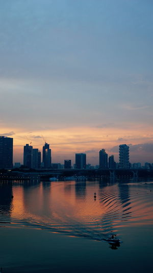 Buildings By Marina Barrage Against Sky During Sunset