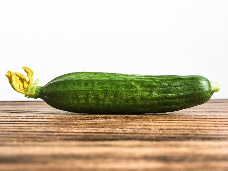 Studio Shot Copy Space Vegetable Food And Drink Still Life Freshness Food Healthy Eating No People White Background Table Green Color Close-up Pumpkin Nature Cucumber Cucumberflower