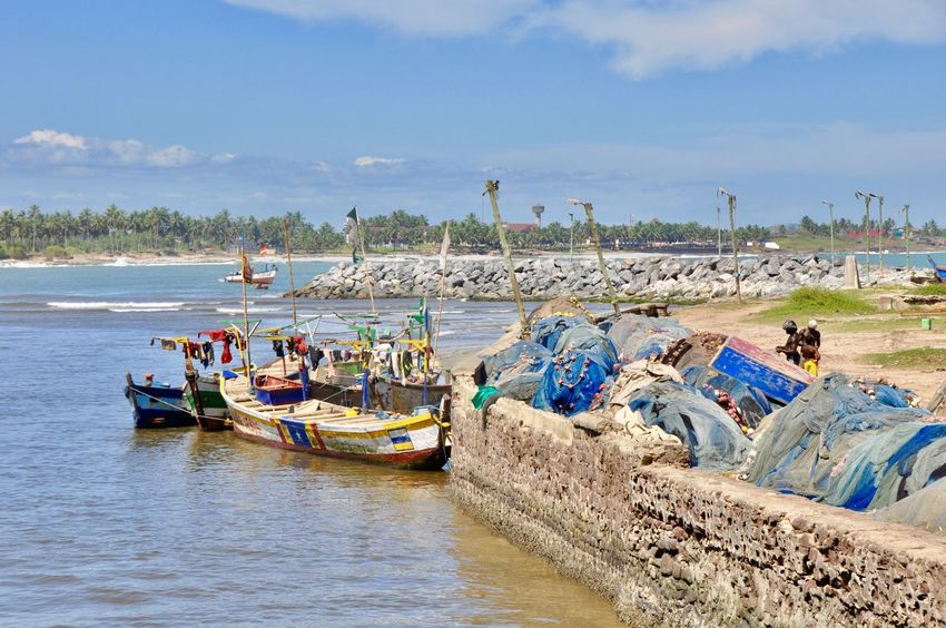Elmina Fishing Village Fishing Net Africa African Beauty Beach Beauty In Nature Cloud - Sky Developing Country Fisherman Fishing Boat Fishing Boat Harbour Fishing Nets Flag Incidental People Moored Multicolored Nature Nautical Vessel Outdoors Poverty Sea Transportation Water
