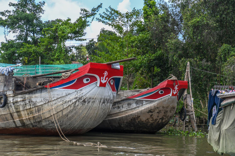 Mekong River Creativity Day Land Mode Of Transportation Moored Nature Nautical Vessel No People Outdoors Plant Red Representation River Sky Transportation Tree Water
