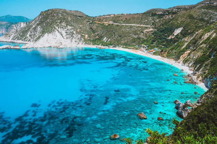 Petani beach. Clear azure blue sea water in beautiful bay. Favorite tourist visiting destination place at summer on Kefalonia island, Greece, Europe Water Beauty In Nature Scenics - Nature Tranquil Scene Blue Mountain Day Nature Tranquility Turquoise Colored No People Sea Non-urban Scene Idyllic Rock Land Solid Rock - Object Outdoors Hot Spring Kefalonia Beach Greece Bay Of Water Turquiose