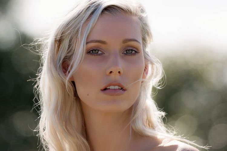 Close-up portrait of young blonde woman
