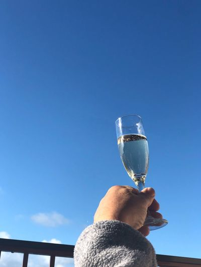 Human Hand One Person Human Body Part Drink Hand Refreshment Body Part Blue Holding Sky Food And Drink Alcohol Nature Glass Copy Space Clear Sky Real People Lifestyles Wine Day