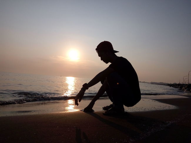 Alone again EyeEm Best Shots EyeEm Nature Lover EyeEm Gallery EyeEm Selects Xiaomiphotography Xiaomiphotograph Xiaomiindonesia Indonesia Photography  Photooftheday Siluet Silhouette Beach Sea One Person Sunset Side View Only Men One Man Only Water People Full Length Adults Only Adult Outdoors Men Horizon Over Water Sky Wave Nature Day
