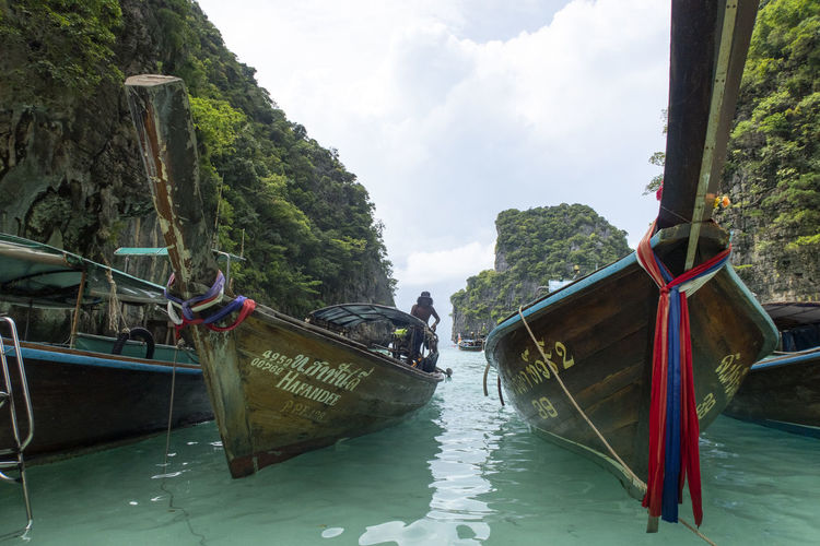 Nautical Vessel Water Transportation Mode Of Transportation Sky Nature Tree Day Moored Plant Longtail Boat Travel River Beauty In Nature Waterfront Cloud - Sky Tranquility Scenics - Nature Outdoors No People Thailand