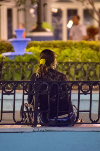 Cuba, noviembre 2016; new and updated photos: Bench Fountain Night Photography Sitting WIFI Zone Waiting Architecture Bag Building Exterior Focus On Foreground Focus On Foreground,shallow Focus Full Length Lifestyles Night One Person Outdoors Park - Man Made Space People Real People Rear View