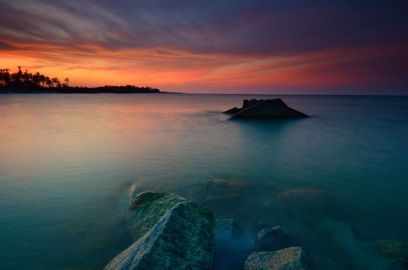 The remnants of old military fortress from world wor II at Kuala Dasar Sabak Beach in Kelantan Malaysia during sunset. Landscape EyeEm Nature Lover Color Landscape Malaysia Wallpaper Sunrise Backgrounds Kelantan EyeEm Amazing View Amazing Water Sea Sunset Beach Tree Blue Summer Reflection Horizon Multi Colored Seascape Romantic Sky Low Tide Dramatic Sky Bay Of Water