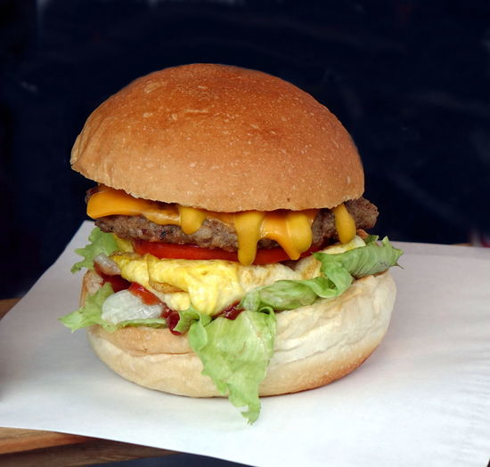 Delicious fresh hand-made burger with cheese, fried egg and lettuce Burger Ready-to-eat Food Bread Hamburger Bun Meat Take Out Food Melted Cheese Fried Egg Fast Food Freshly Made Lettuce Cuisine American Food