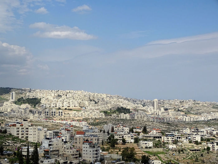 Bethlehem in Palestinean Territories with settlement Architecture Building Exterior Built Structure City Cityscape Cloud - Sky Community Crowded Day House Nature Outdoors People Residential Building Residential District Sky Town Settlement Jewish Settlement Jewish West Bank Palestine Palestinian Territory Bethlehem