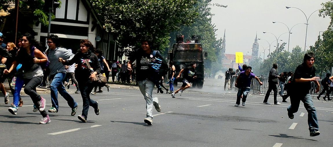 The Photojournalist - 2015 EyeEm Awards A mob of youngsters scattered anteal truck sudden appearance of a police water cannons during a demonstration in favor of a free education. Riot Police RiotSociety Color Photography