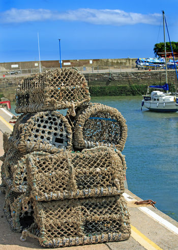 Crab Baskets on the docks Cloud Cloud - Sky Coastline Crab Basket Day English Riiveria Fishing Village Harbor Large Group Of Objects Nature No People Outdoors Paignton Scenics Sea Sky Tranquility Travel Destinations Water