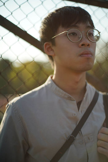 One Person Real People Front View Portrait Glasses Eyeglasses  Leisure Activity Young Adult Lifestyles Focus On Foreground Young Men Headshot Day Close-up Looking Sport Child Teenager Outdoors Adolescence  Teenage Boys Contemplation