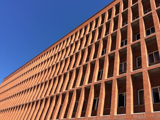 Architecture Building Exterior Built Structure Low Angle View Clear Sky Outdoors Day No People Check This Out Hanging Out Taking Photos Enjoying Life Architecture Ciudad Universitaria Madrid Architecture_collection Building Urban Geometry Blue Sky Brick Building Architectural Feature University Campus University The Architect - 2017 EyeEm Awards The Architect - 2018 EyeEm Awards