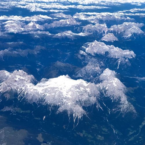 Looking Down Mountain Range The Alps Beauty In Nature Nature Blue Scenics - Nature Environment Snow Outdoors Tranquil Scene