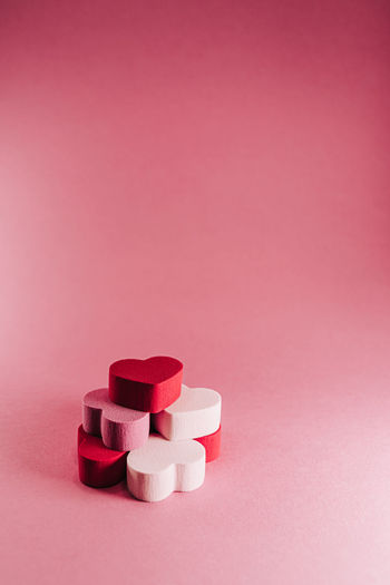 Close-up of pink stack against colored background