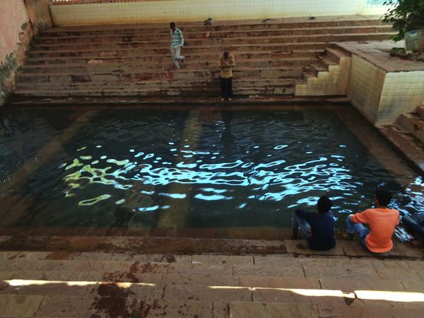 Water Swimming Reflection High Angle View Sitting Wet Floating On Water Real People Day Adult Travel Destinations Swimming Pool One Person Only Women People Outdoors India First Eyeem Photo Gujatrat Likeforlike Step Well Warm Water Well Indian Adventure Two People