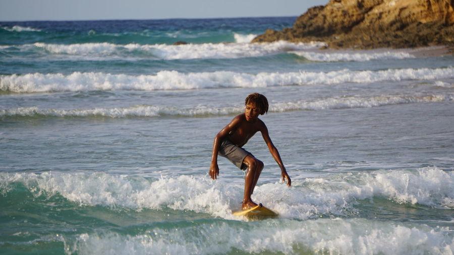 surfboy Surfing #Nature  #EyeEmNewHere #mosambik #water #ocean #travelphotography Wave Athlete Water Sea Sport Beach Motion