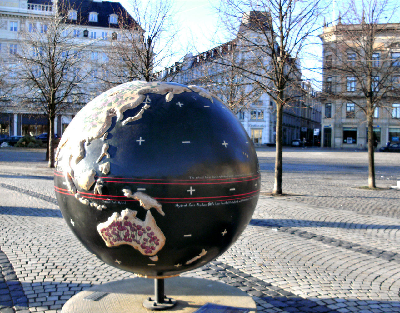 building exterior, architecture, city, built structure, day, bare tree, street, tree, nature, building, outdoors, no people, winter, close-up, sphere, mode of transportation, transportation, cold temperature, snow, sunlight