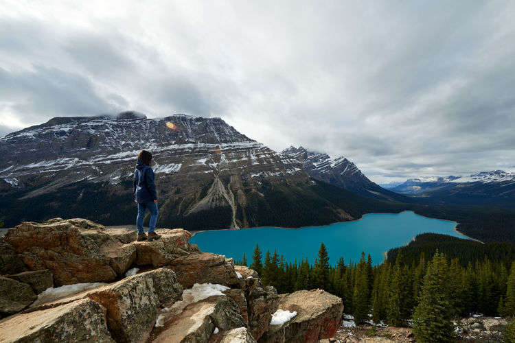 Man looking at mountain against sky