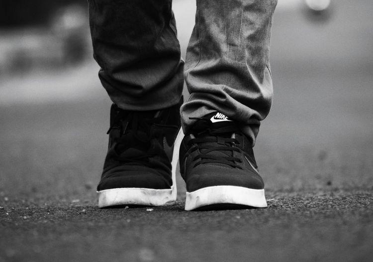 Nike Blackandwhite Low Section Men Footwear Shoe Human Leg Shoelace Human Foot Ground Feet Pair Canvas Shoe Flat Shoe The Art Of Street Photography The Traveler - 2019 EyeEm Awards The Street Photographer - 2019 EyeEm Awards