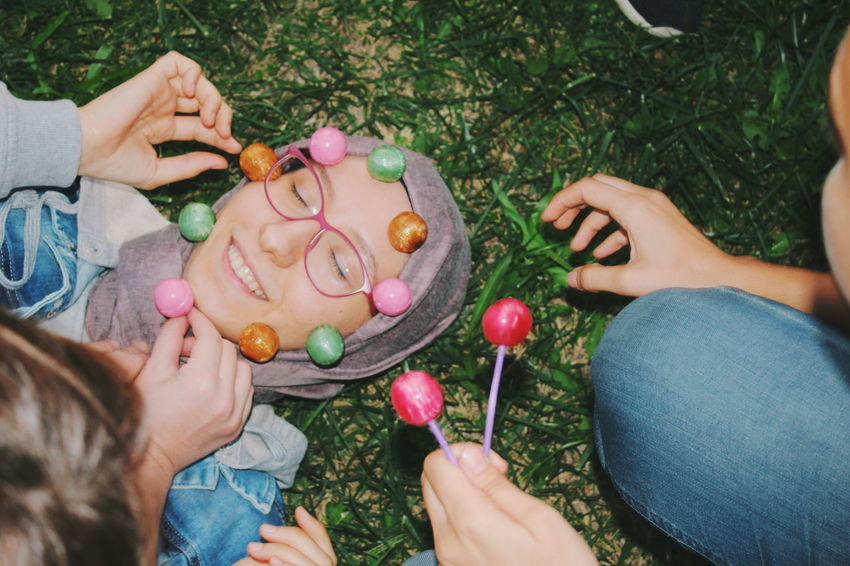 Every body obtains unique personality Portrait Happiness Sweet Art Weird Lollipop Art And Craft Human Hand Friendship Low Section Young Women Women Togetherness