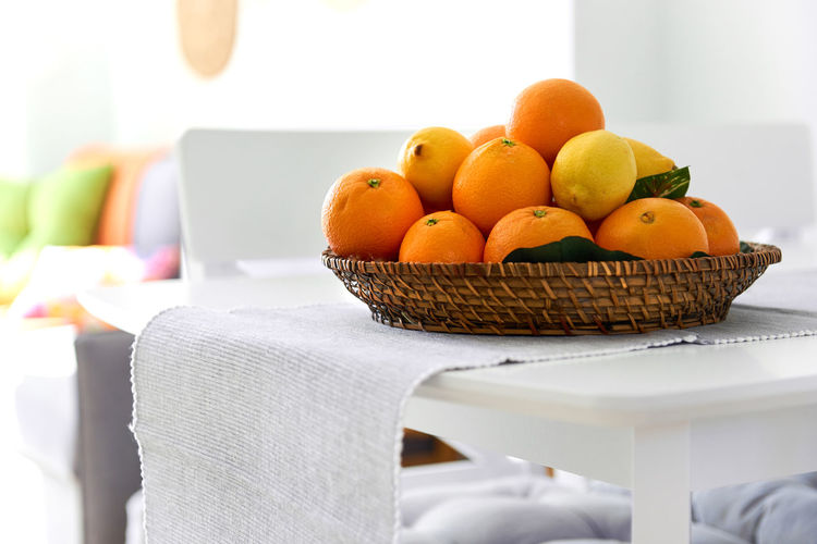 Fresh lemons and mandarin orange fruits on a wicked plate Citrus  Mandarin Oranges Objects Room Basket Citrus Fruit Close-up Day Daylight Food Food And Drink Fresh Freshness Fruit Healthy Eating Indoors  Indoors  Lemon Mandarin No People Nobody Table Tablecloth Tangerines Wicked