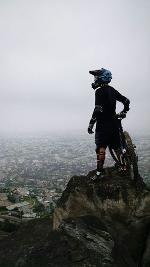 Mountain bike One Man Only One Person Outdoors Cityscape Sky Travel Sport Bike Ride Downhill Mountain Rocks