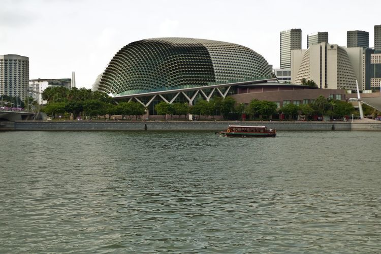 Singapore's Theatres on the Bay performance arts complex, Marina Bay. Singapore Architecture Building Building Exterior Built Structure City Cityscape Day Marina Bay Modern Nature Nautical Vessel No People Office Building Exterior Outdoors River Sky Skyscraper Theatres On The Bay Transportation Travel Travel Destinations Waterfront
