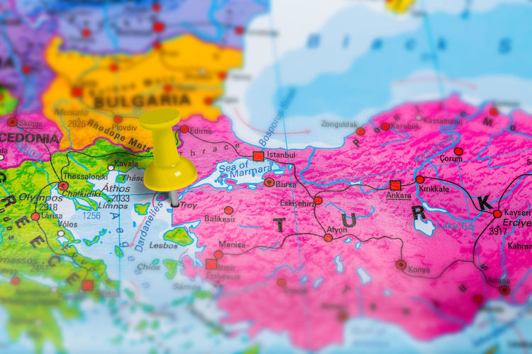 capital city pinned on colorful political map of Europe. Geopolitical school atlas. Tilt shift effect. Atlas City Geography Map Marked Place Travel Capital Cities  Close-up Day Europe Geology Indoors  Map Multi Colored No People Pink Color Pinned Selective Focus Text Town Travel Destinations Treveling Troy