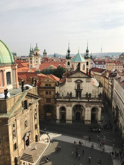 Tourists in front of historic churches in prague