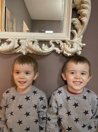 Portrait of smiling twin boys