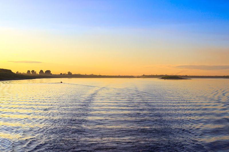 Evening at river Tom in Tomsk. Clear Sky Horizon Idyllic No People Non-urban Scene Orange Color Outdoors Reflection River Scenics - Nature Siberia Sky Sunset Tranquil Scene Tranquility Water Water Surface Waterfront